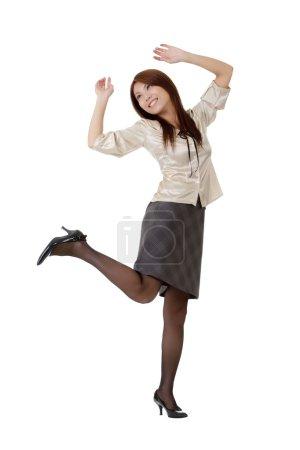Photo pour Heureuse femme d'affaires dansant et souriant isolé sur blanc . - image libre de droit