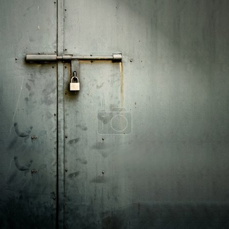Photo for Closeup metal door with lock in grungy style and good texture. - Royalty Free Image