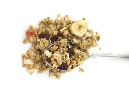Breakfast concept : muesli with spoon isolated on white. Top vie