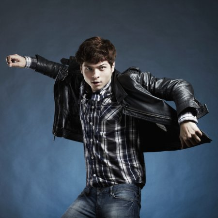 Portrait of the young beautiful man in a jump