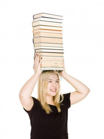 Woman with a pile of books on her head