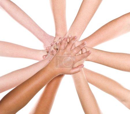 Photo pour Les mains humaines les unes sur les autres isolées - image libre de droit