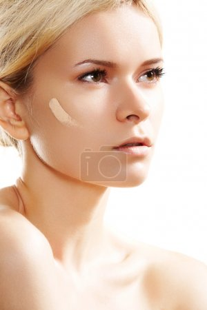 Skin care and cosmetics. Woman applying skin tone foundation