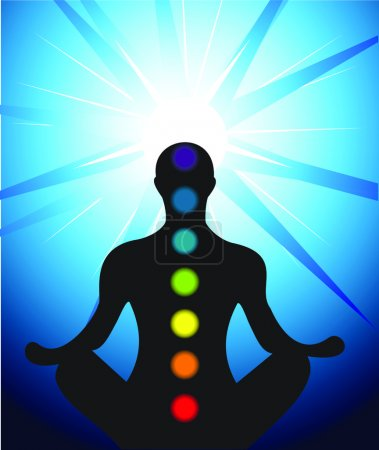 Male silhouette meditating with chakra