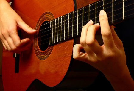Photo for Closeup view of playing classic spanish guitar - Royalty Free Image