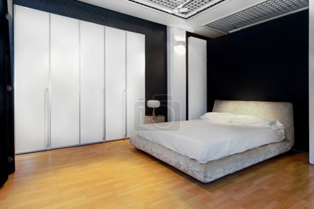 Photo for Bedroom interior with big white wardrobe closet - Royalty Free Image