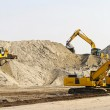 Heavy machinery equipment at road construction sit...