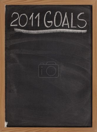 Photo for 2011 goals title handwritten with white chalk on blackboard with copy space below for New Year tasks and resolutions - Royalty Free Image