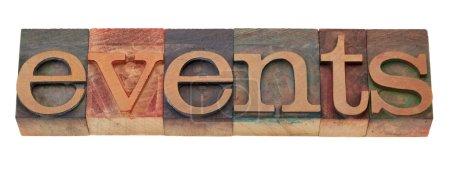 Photo pour Evénements mot dans les blocs d'impression de typographie en bois vintage, teinté par des encres de couleur, isolé sur blanc - image libre de droit
