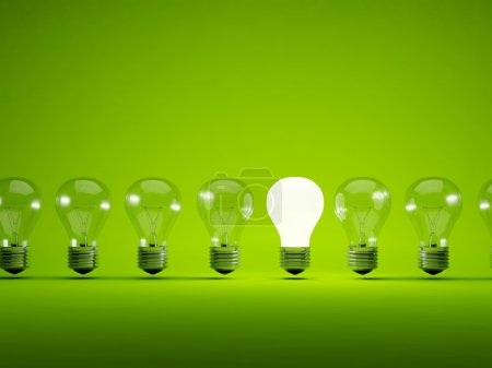 Photo for Turn on bulb on green background - Royalty Free Image