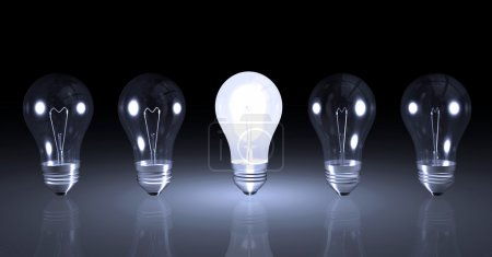 Photo for Image one lit light bulb next to other unlit bulbs. - Royalty Free Image