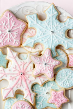 Photo for Cookies decorated with pink and blue snowflakes - Royalty Free Image