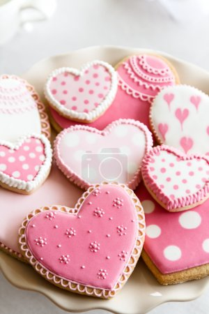 Photo for Heart shaped cookies with pink and white icing - Royalty Free Image