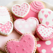 Heart shaped cookies with pink and white icing...