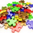 The background unsolved bunch of jigsaw puzzles pi...