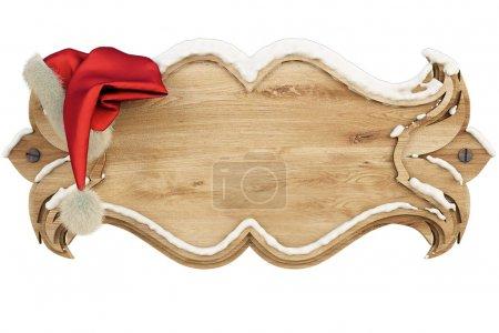 Photo pour Sur une bannière en bois recouverte d'un chapeau suspendu à la neige du Père Noël. isolé sur blanc, y compris le chemin de coupe - image libre de droit