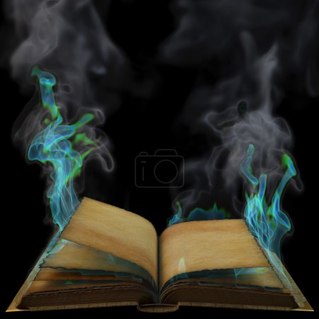 Photo for Old empty open book in the magical flames. isolated on black. - Royalty Free Image