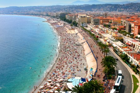 Photo for Luxury resort of French riviera. Beautiful panorama city of Nice in France. Sunny, summer day. Mediterranean sea, public beach, famous quay, palms and houses of - Royalty Free Image