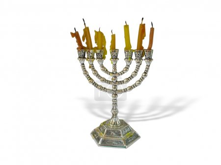 Hanukkah candles in a menorah on white background