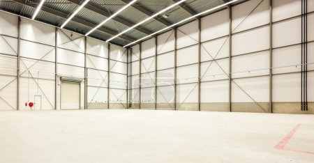 Photo for Interior of a huge emptyt warehouse - Royalty Free Image