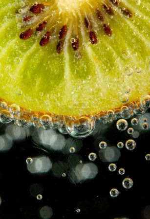 Photo for Close-up of a wet juicy kiwi slice - Royalty Free Image