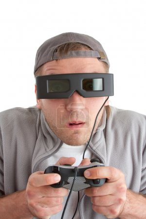Surprised player with joystick and 3-D glasses