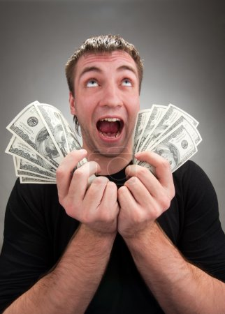 Very excited man with money