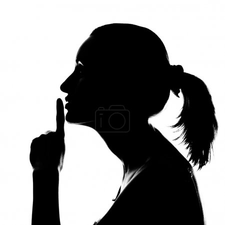 Silhouette of woman with hush sign