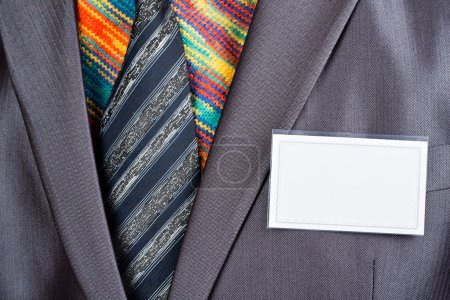 Businessman in grey suit and colorful shirt