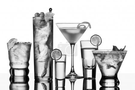 Photo for Five vodka drinks on glass surface with reflection, white background - Royalty Free Image