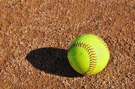 Yellow Softball on the Infield
