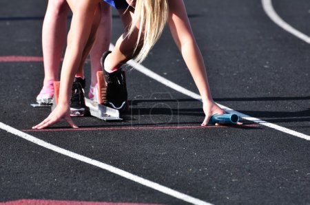 Photo for Teen Girl in the Starting Blocks at a Track Meet - Royalty Free Image