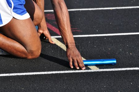 Photo for Teen Boy in the Starting Blocks at a Track Meet - Royalty Free Image