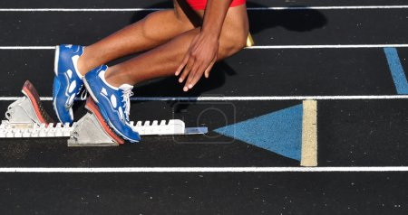 Photo for Teen Boy Leaving the Starting Blocks at the Start of a Race - Royalty Free Image