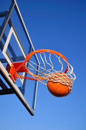 Basketball Shot Falling Through the Net, Blue Sky