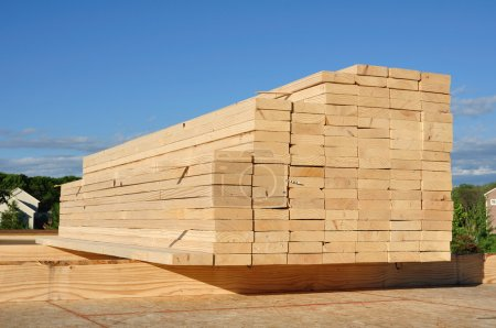 Close-up of Stacked Lumber for construction, backg...