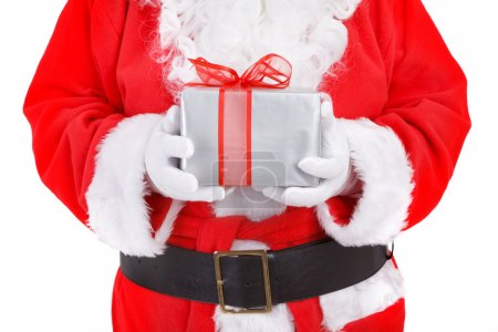 Photo for Santa holding present isolated on white background, focus set on present - Royalty Free Image