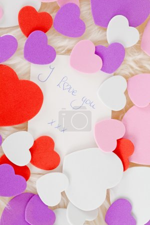 Photo for Romantic note: I love you with colorful hearts in closeup - Royalty Free Image
