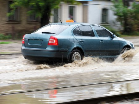 Flood: a car moving over large puddle