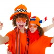 Young couple in orange outfit is supporting the Du...