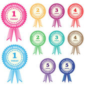 Birthday rosettes for children from 1 year to 5 years in assorted boy and girl colors Isolated on white