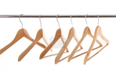 Photo for Hangers on a clothes rail, isolated on white - Royalty Free Image