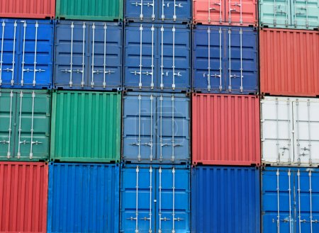Multi-colored freight shipping containers at the docks