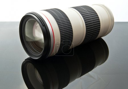 Photo for Camera lens with reflection on the black glass - Royalty Free Image