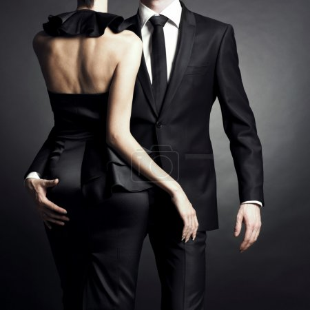 Photo for Conceptual portrait of a young couple in elegant evening dresses - Royalty Free Image