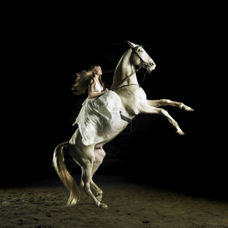 Photo for Beautiful blonde in a white dress on a white horse - Royalty Free Image