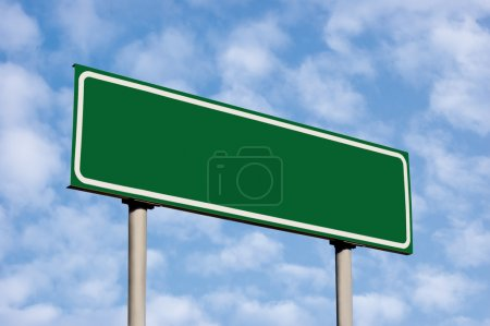 Empty Green Road Sign Against Light Cloudscape Sky