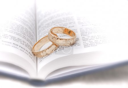 Photo for Gold wedding rings on a bible. Shallow depth of field. - Royalty Free Image