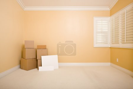 Moving Boxes and Blank Signs on Floor in Empty Room