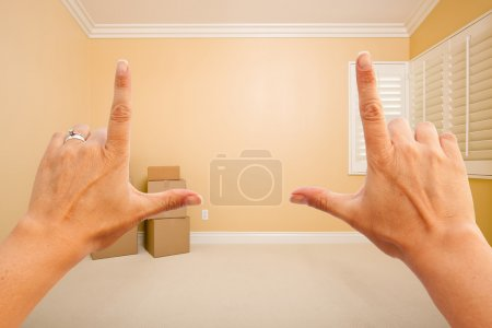 Photo for Female Hands Framing Beautiful Room Interior Imagining What to Do with the Room. - Royalty Free Image